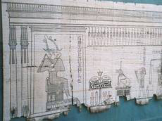 Egyptian papyrus showing god Osirus weighing human heart (image)