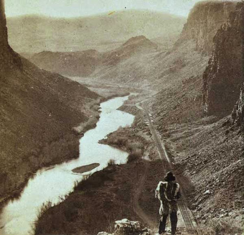 Native American looking at transcontinental railway in Nevada, c. 1868 (image)